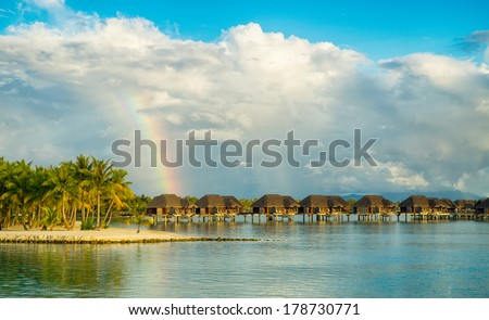 Rainbow over paradise - stock photo