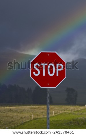 Rainbow over stop sign