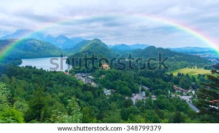 Rainbow over the castle in Bavaria - stock photo