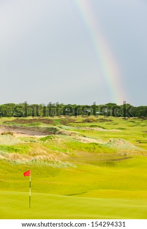rainbow over the golf course, St Andrews, Fife, Scotland - stock photo