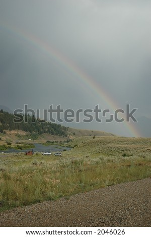 Rainbow over the Madison River - stock photo