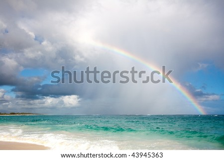 Rainbow over the ocean - stock photo