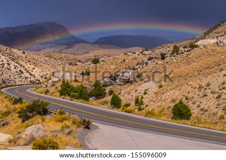 Rainbow over the road leading to Bighorn National Forest