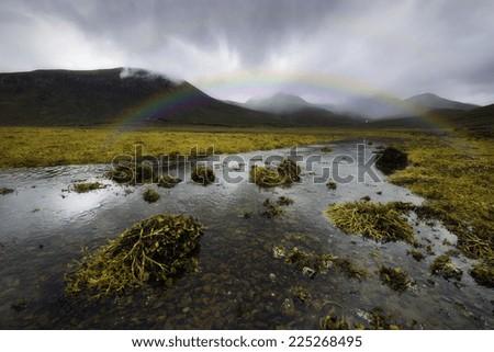 Rainbow over the Scottish Highlands, Isle of Skye - stock photo