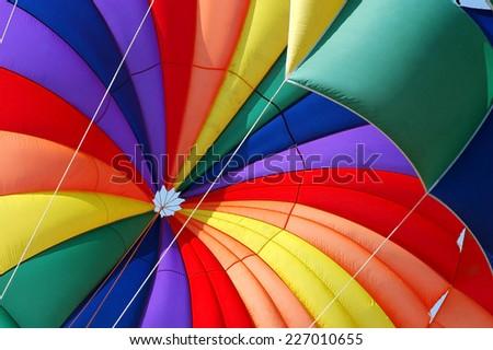 Rainbow Parachute on the beach. Para sailing and adrenaline - stock photo