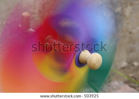Rainbow pinwheel in motion - stock photo