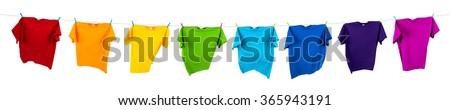 rainbow shirts on washing line - stock photo