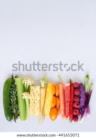 Rainbow spectrum gradient of healthy fresh fruit and vegetables,  colourful food background - stock photo