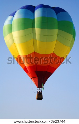 Rainbow Stripes Hot Air Balloon - stock photo