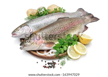 Rainbow trout with fresh herbs isolated on white background - stock photo