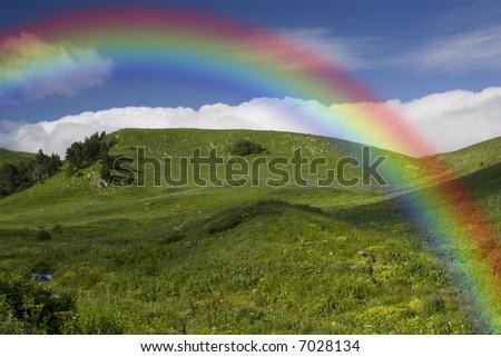 rainbow under the green field - stock photo