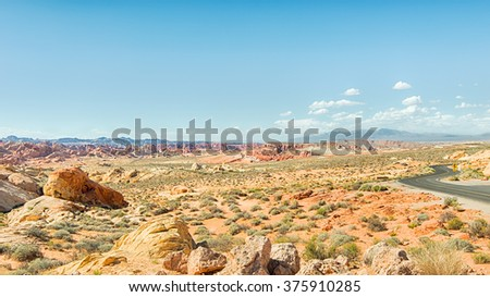 Rainbow Vista with the Mormon Mountains in background, in Valley of Fire State Park, near Las Vegas, Nevada. - stock photo