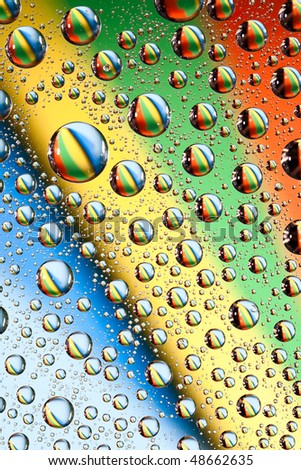 Rainbow water drops. Water collection. - stock photo