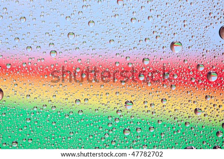 Rainbow water texture on a glass. Nature collection. - stock photo