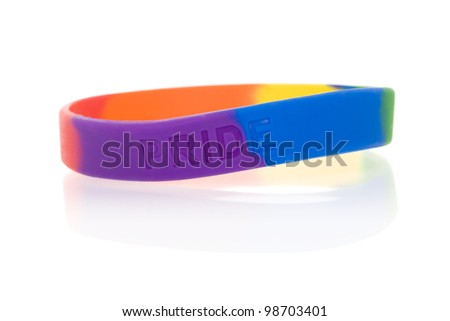 "Rainbow wristband inscribed with the word ""pride"" (not a brand name). - stock photo"