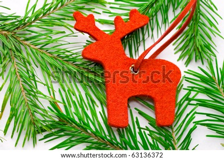 Raindeer and fir isolated on white - stock photo