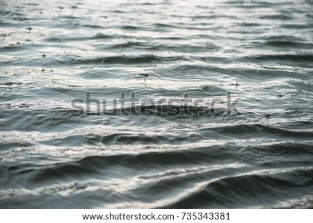 Raindrop impact on rippling water surface