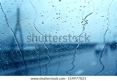 raindrop on car window - stock photo