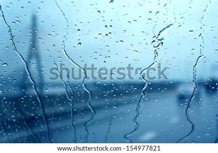 raindrop on car window - stock photo