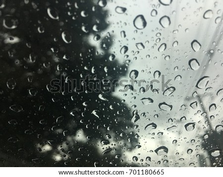 Raindrop on the window glass, black and white background