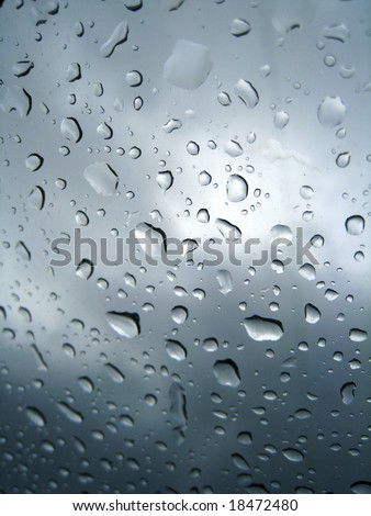 raindrops in a circular pattern on window - stock photo