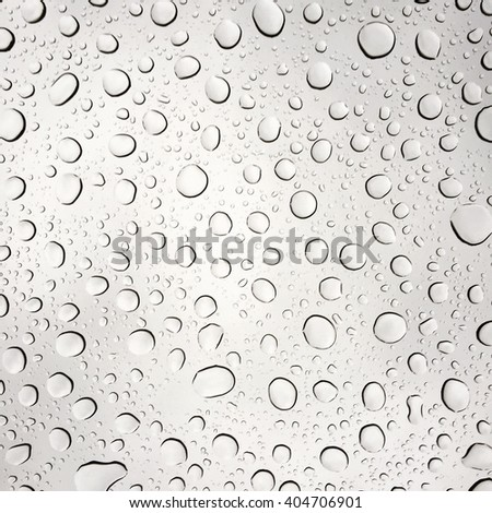 Raindrops on a clear glass pane. - stock photo