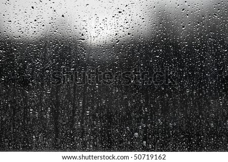 Raindrops on a window surface - stock photo