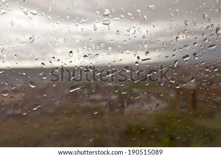Raindrops on a windowpane - stock photo