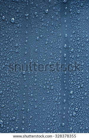 Raindrops on blue metal surface - stock photo