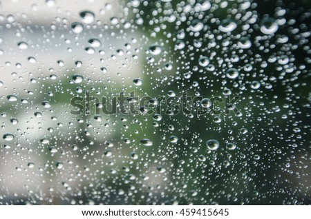 raindrops on glass car, water drop - stock photo