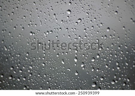 raindrops on glass, shallow focus - stock photo