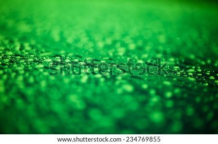 Raindrops on green surface metal  - stock photo