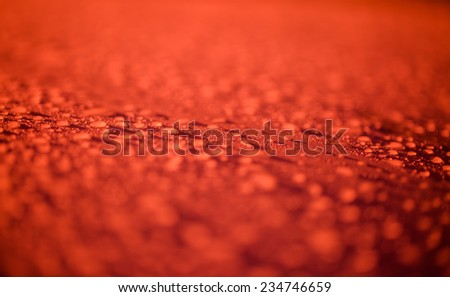 Raindrops on red surface metal  - stock photo