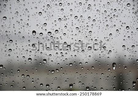 raindrops on the glass - stock photo