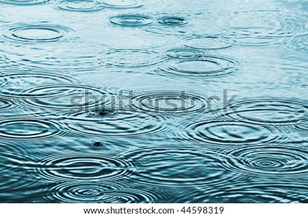 Raindrops on the water - stock photo