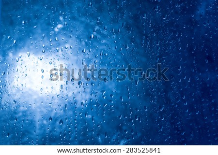 Raindrops on the window in the back light.