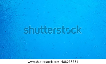 raindrops on water in swimming pool