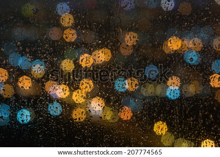 raindrops on window at night - stock photo