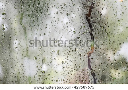 raindrops on window glass abstract background - stock photo