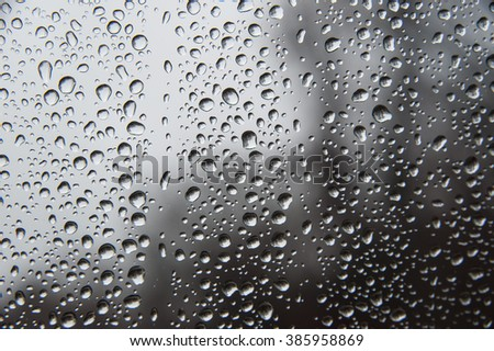 Raindrops on windshield acting as tiny lenses