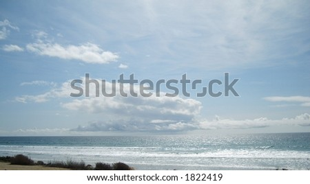 Raining cloud over the ocean - stock photo
