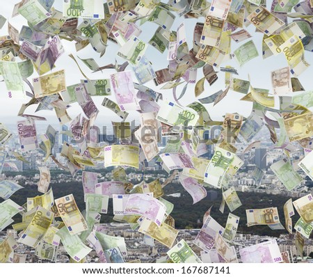 Raining euro on city background  - stock photo