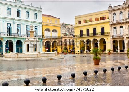 Raining in La Plaza Vieja, a touristic landmark in Old Havana - stock photo