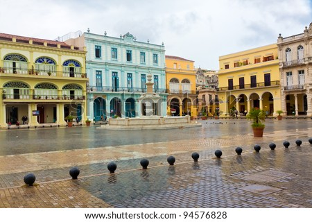 Raining in La Plaza Vieja, a touristic landmark in Old Havana - stock photo