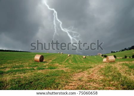 raining sky over the field - stock photo