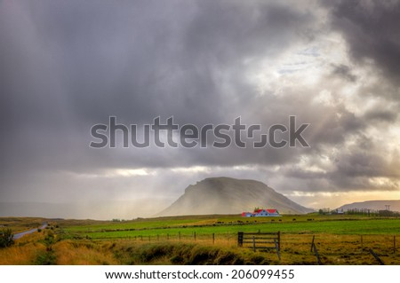 Rainstorm over a farm in Iceland