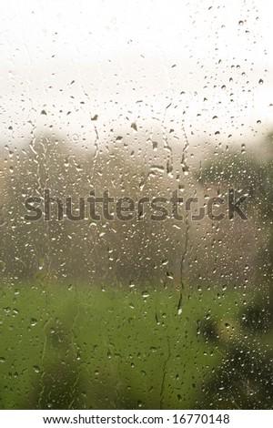 Rainy autumn window in 3 stripes - white, dark, green - stock photo