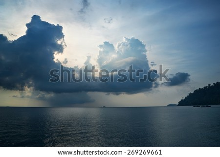 rainy clouds on the beach of Tioman island - stock photo