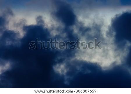rainy dark cloud before storm, soft focus - stock photo