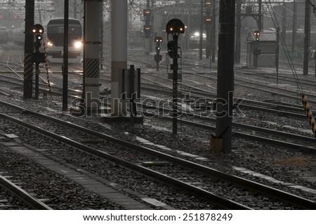 Rainy day at japanese railway station with many railways - stock photo